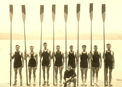 Rowing team with oars up.
