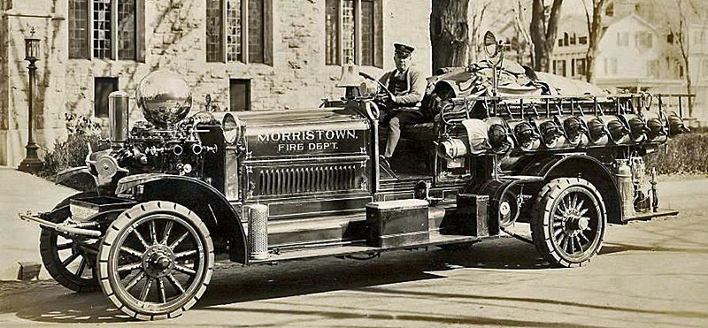 photo showing an earlier style of decoration on a 1918 Ahrens-Fox fire engine.