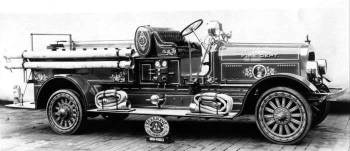 1925 Seagrave fire engine with gold scrolls and oil paintings.