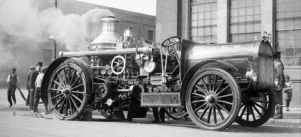 old photo of FDNY engine 68 with gold stripes and letters on huge hood.