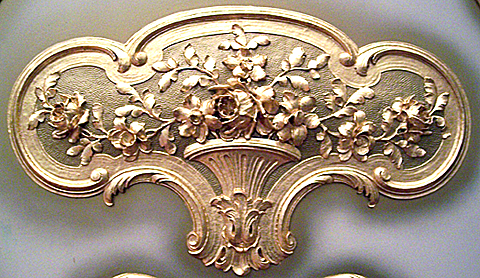 Gilding on the consol of a Wurlitzer pipe organ.