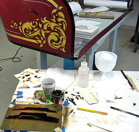 Tools for applying the asphaltum shading on the gold scroll.