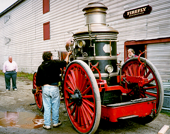 John Peckham, Andy Swift and Ken Soderbeck at Firefly Restoration with an Amoskeag steam fire engine.