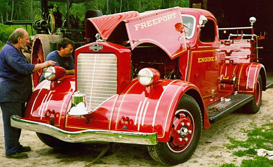 Andy Swift and Tom P. tuning 1939 American LaFrance fire engine.