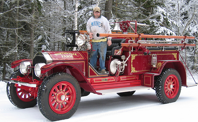 Mainer Andy Swift dresses up to deliver 1924 American LaFrance fire engine.