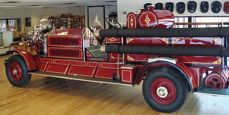 Side view of restored 1928 Ahrens-Fox fire engine.