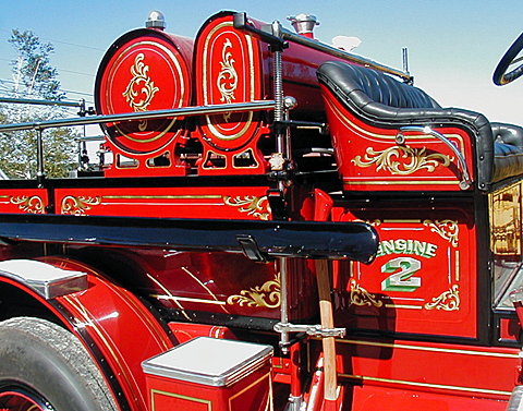 Standard factory decoration restored on a 1925 Ahrens-Fox fire engine by Peter Achorn.
