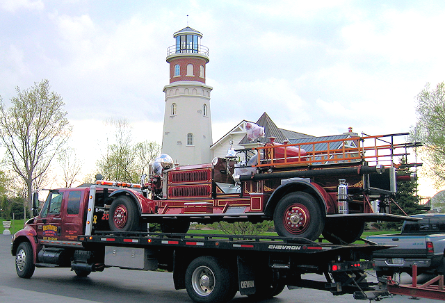 Restored 1931 Ahrens-Fox being delivered to Great Lakes lighthouse.