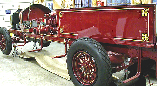 1926 Maxim fire engine being restored by the owner, with decoration by Peter Achorn.