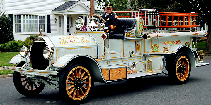 1921 Seagrave fire engine with lettering and scrolls by Ken Soderbeck and stripes by Peter Achorn.