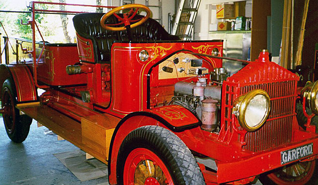 Bangor F. D. restoration on Garford fire engine in Fire Gold shop being decorated.