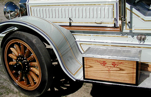 1921 Seagrave fire engine gold stripes and thin red lines.