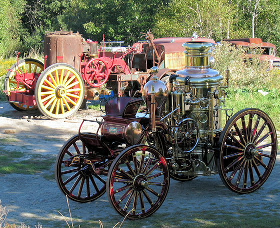 Two Amoskeag fire engines at Firefly Restoration