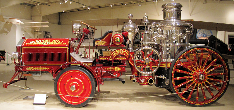 restored 1904 Amoskeag steam fire engine with an American LaFrance tractor.