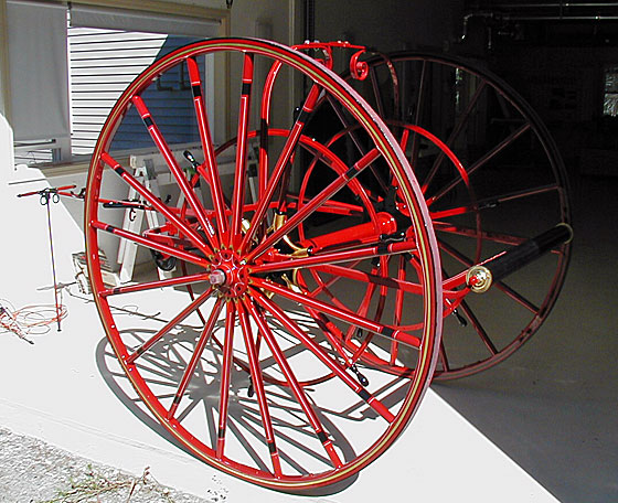 Nott hose cart restored by Firefly Restoration